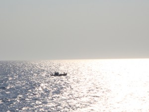 A boat on the silver sea